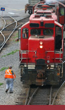 A picture of a red train and worker