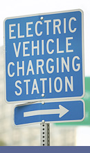 A picture of a sign depcting Electrical Vehicle Recharging Station